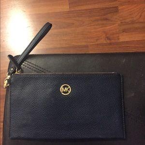 Michael Kors envelope bag.